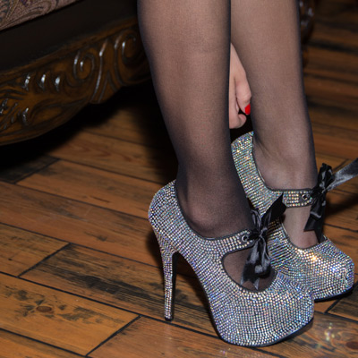 Closeup of pantyhose and high heels