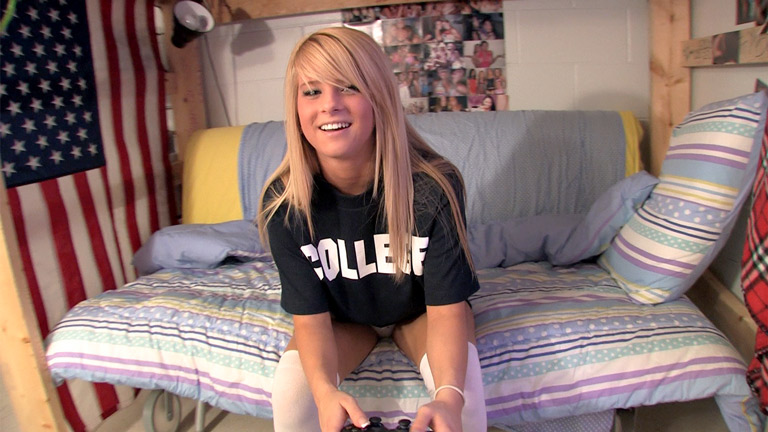 Blonde college girl playing video games